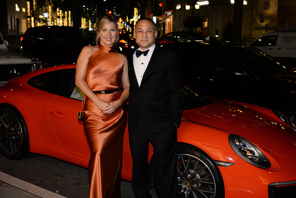 One of the private Sponsors: Melinda Borbely and Jon White M.D. with the displayed Porsche