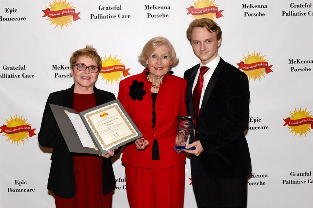 From left to right: Eva Konkoly, Director, Ambassadors of the Future Board, Eva E. Voisin, Esq. Honorary Consul, Adam Beres, President, Ambassadors of the Future at the Bognar Family Scholarship presentation